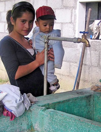 Locals in Los Regadillos getting water from the United by Friendship water project development.